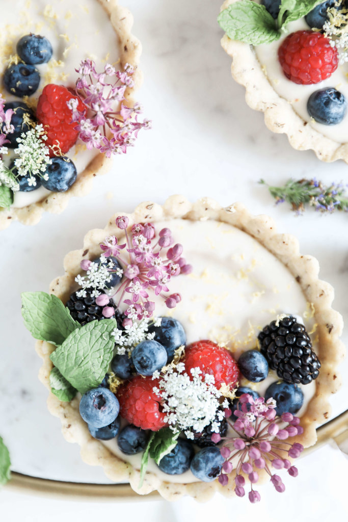 Sweet almond tarts filled with creamy, cashew based cheesecake and topped with an assortment of fresh berries: Jessi's Kitchen